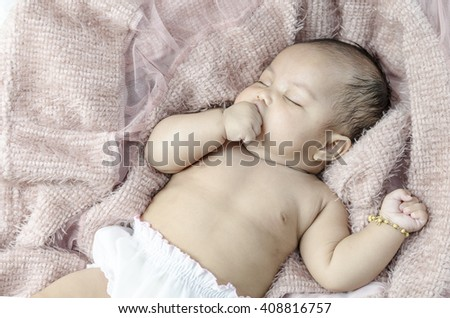Portrait of a beautiful Asian baby girl - stock photo