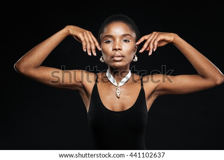 Portrait of a beautiful attractive ethnic african woman isolated on the black background - stock photo