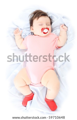 Portrait of a beautiful baby sleeping on a white towel. - stock photo