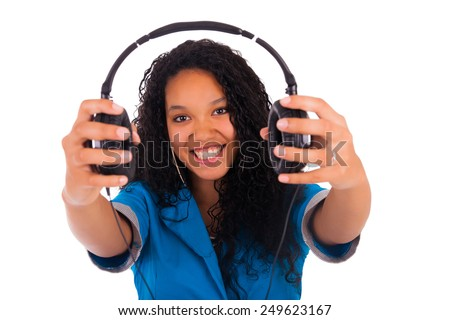 Portrait of a beautiful black woman with headphones listening to music isolated - stock photo