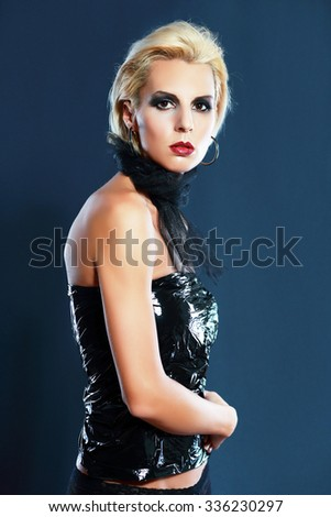 portrait of a beautiful blond girl in lingerie with bright make-up - stock photo