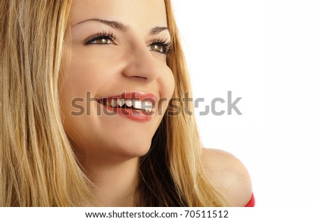 Portrait of a beautiful blond woman smiling - stock photo