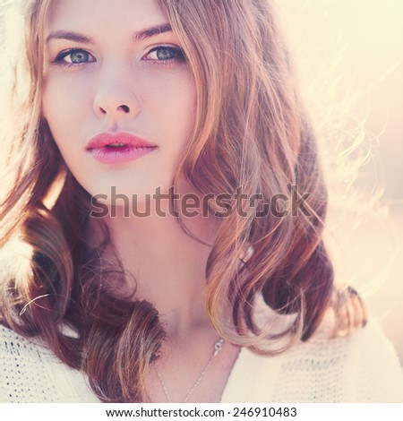 portrait of a beautiful blonde close-up. Photo in violet tones - stock photo