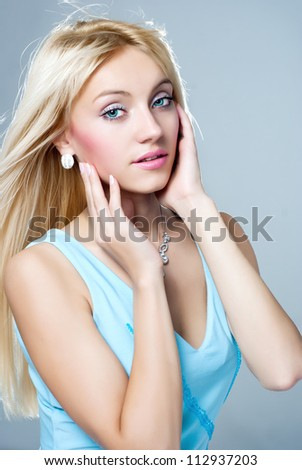 portrait of a beautiful blonde girl - stock photo