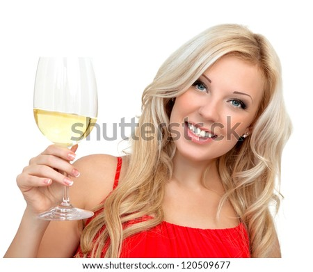portrait of a beautiful blonde girl in a red dress with a glass of wine for the holiday - stock photo