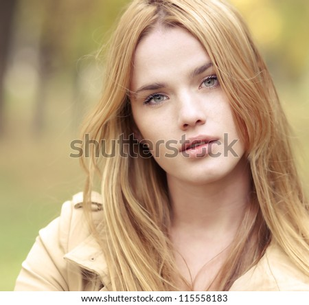 portrait of a beautiful blonde in autumn - stock photo