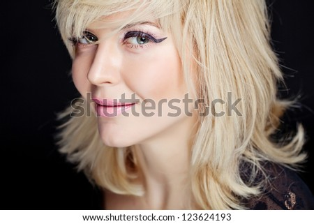 Portrait of a beautiful blonde in the black - stock photo