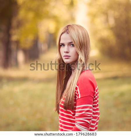 portrait of a beautiful blonde in the park - stock photo