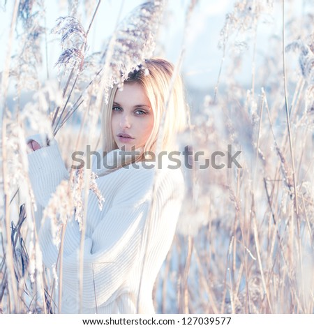 portrait of a beautiful blonde in the winter - stock photo