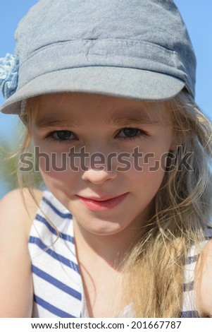 Portrait of a beautiful blonde little girl - stock photo