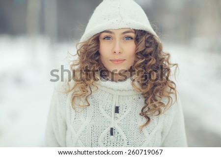 portrait of a beautiful blonde winter outside - stock photo