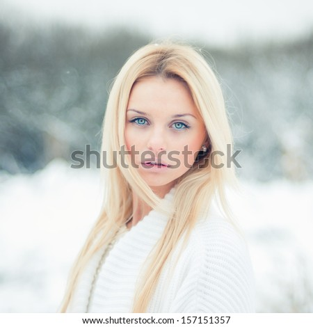 portrait of a beautiful blonde with a sexy look - stock photo