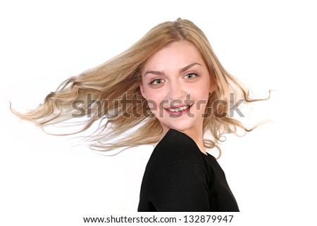 Portrait of a beautiful blonde with flying hair on white background - stock photo