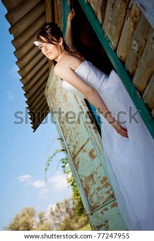 Portrait of a beautiful bride on the nature - stock photo