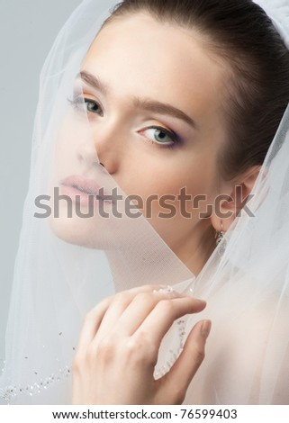Portrait of a beautiful bride with bright makeup - stock photo