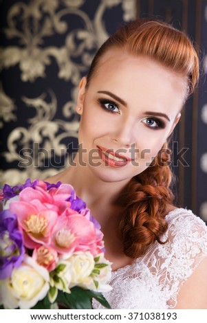 Portrait of a beautiful bride with flowers  - stock photo