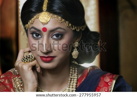 Portrait of a beautiful bride with jewelery - stock photo