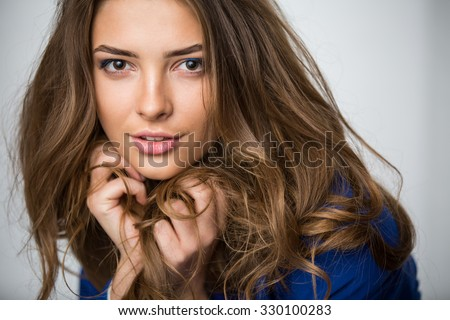 Portrait of a beautiful brown-haired girl - stock photo