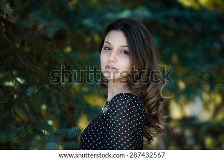 Portrait of a beautiful brunette.Beautiful smiling girl - stock photo