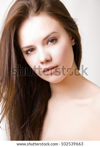 Portrait of a beautiful brunette girl - stock photo
