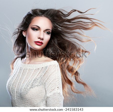 Portrait of a beautiful brunette girl with fluttering hair with wind. Windy hair - stock photo