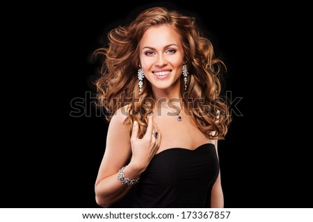 portrait of a beautiful brunette girl with luxury accessories.Beauty with jewelery. happy fashion model  - stock photo