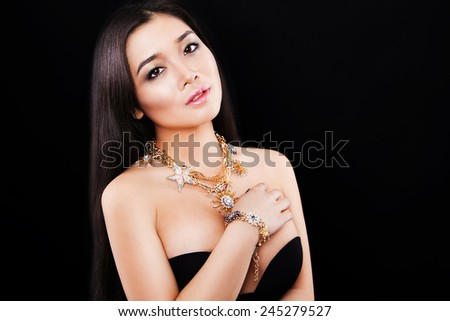 portrait of a beautiful brunette girl with luxury accessories.Beauty with jewellery. happy fashion model - stock photo