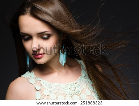 Portrait of a beautiful brunette with windy hair - stock photo