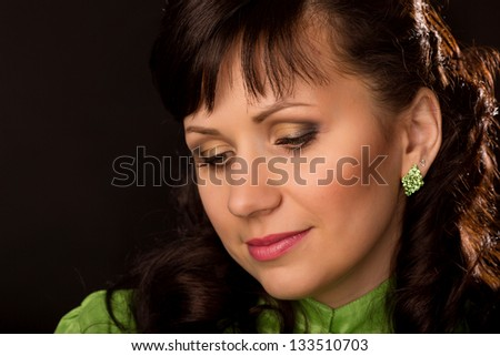 Portrait of a beautiful brunette woman on back backgound - stock photo