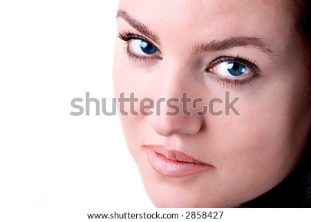Portrait of a beautiful brunette woman with blue eyes. - stock photo