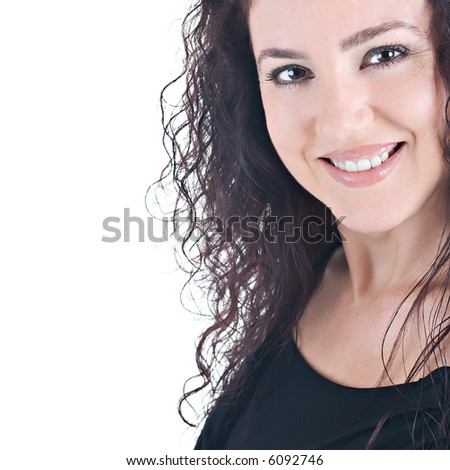 Portrait of a beautiful brunnette with curly hair, smiling. Isolated on white background. - stock photo