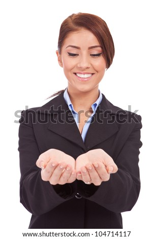 Portrait of a beautiful business woman holding something on her hand,  Isolated on white background - stock photo