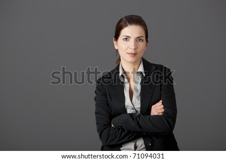 Portrait of a beautiful business woman, over a gray background - stock photo