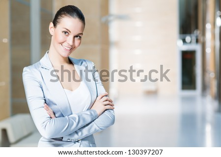 portrait of a beautiful business woman, smiling and crossed her arms - stock photo