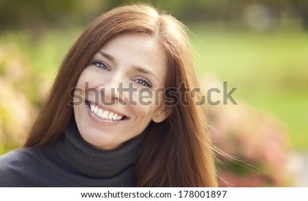 Portrait of a beautiful Caucasian woman outdoor - stock photo