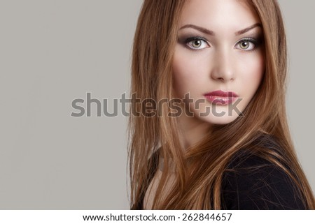 portrait of a beautiful charming attractive gentle girl with expressive eyes - stock photo