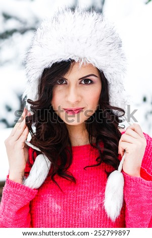 portrait of a beautiful, cheerful girl in winter - stock photo