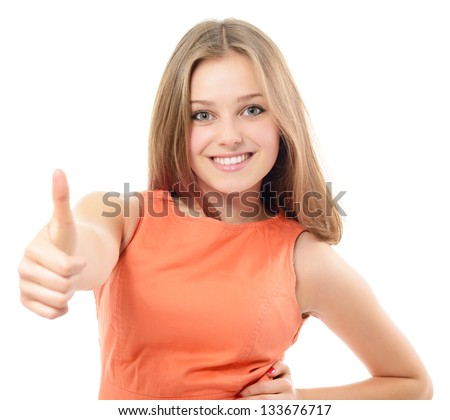 Portrait of a beautiful, confident and cheerful teenager girl showing thumbs up isolated on white - stock photo