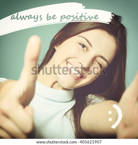 Portrait of a beautiful, confident and cheerful teenager girl showing thumbs up with positive message - stock photo