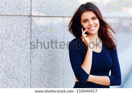 Portrait of a beautiful confident businesswoman talking on phone - stock photo