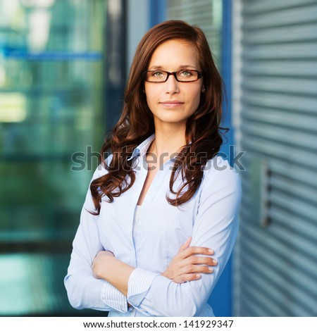 Portrait of a beautiful confident female executive, looking into the camera. - stock photo