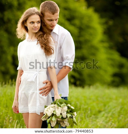 portrait of a beautiful couple in love - stock photo