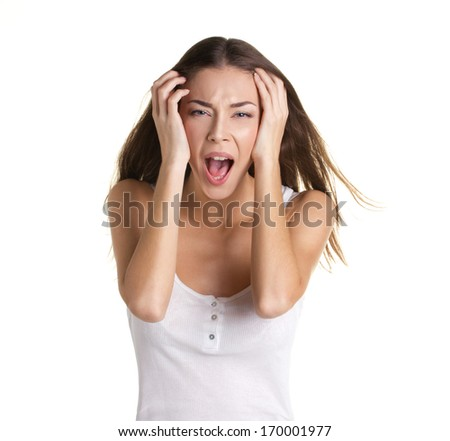portrait of a beautiful crying young woman with long hear, in white tank top, on white background - stock photo
