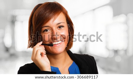 Portrait of a beautiful customer representative at work - stock photo