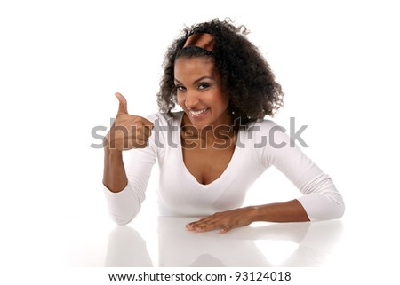 portrait of a beautiful dark-skinned woman with hand up in a white dress in the studio - stock photo
