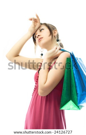 portrait of a beautiful elegant young woman tired of shopping - stock photo