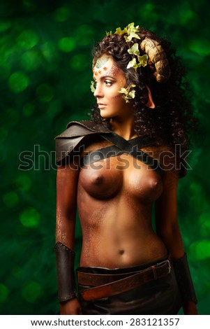 Portrait of a beautiful fabulous female Faun. Myth and fantasy. Body painting project. - stock photo