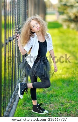 portrait of a beautiful fashion little girl - stock photo