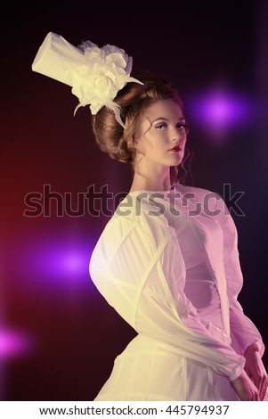 Portrait of a beautiful fashion model in the refined white dress and elegant hat. Snow queen. Winter fantasy. - stock photo