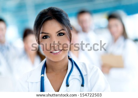Portrait of a beautiful female doctor at the hospital   - stock photo